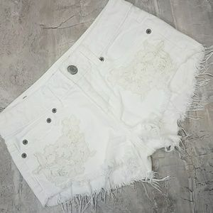 White shorts distressed jeans American Eagle